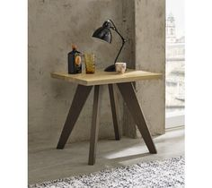 The Cadell Aged & Weathered Oak Lamp Table, with its organic lines and finely tapered legs, will blend in perfectly into any modern living or dining space. With sleek weathered oak legs and contrasting knotty aged oak top, this lamp table is the epitome of modern style and elegance.