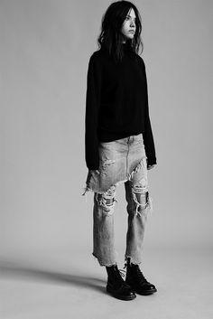 Ripped denim skirt worn over denim pants / Doc Martens. grunge vibes