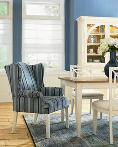 """HGTV HOME Furniture Collection """"Water's Edge"""" comfy wing chair is perfectly scaled for dining - Area Rug in style """"Ethos"""" by HGTV HOME Flooring by Shaw. Cozy Living Rooms, Home And Living, Dining Chairs, Dining Room, Dining Area, Kitchen Eating Areas, Hgtv Designers, Striped Chair, Wing Chair"""