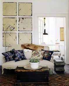 not loving the ceiling tins on the wall, but dig the settee, trunk, rugs, etc