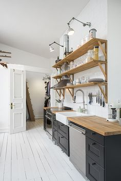 only lower cabinets, upper shelving, line kitchen, farmhouse sink, vertical space, tiny space