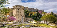 """The Tower of the Winds  is an octagonal Pentelic marble clocktower in the Roman Agora  in Athens that functioned as a horologion or """"timepiece"""""""