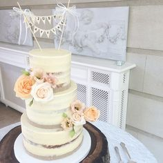 Semi naked buttercream cake with fresh blooms by The Cake Cuppery for today's wedding at  Tankardstown House