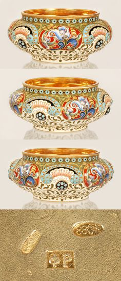 An impressive Russian silver gilt and shaded cloisonne enamel bowl, Feodor Ruckert, Moscow, 1896-1908. The circular bowl with raised oval lobes decorated in shaded multi-color floral and foliate motifs with alternating grounds of cream, red and turquoise blue against an overall olive green and cream ground