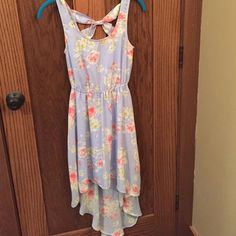 Summer dress Sky blue summer dress. Super cute worn once. Like brand new. Pink, white, and yellow flower pattern. Tighter at Waste. Crisscross in the back. High low. Size juniors XS. Under lined. Candie's Dresses High Low