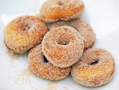 The mini donut was born in the forties, when Tom Thumb donut machines cranked out teeny versions of the much loved breakfast pastries at the rate of three dozen per minute. The machines didn't catch on for a decade or so, then quickly became popular at state fairs and carnivals, where people loved to watch them at work, churning out donuts that were then doused in cinnamon sugar and served warm as a snack. To this day people associate mini donuts with summer midways, but they're…
