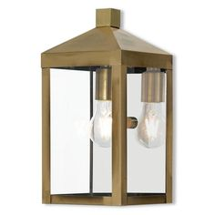 Livex Lighting 1 Light Antique Brass Outdoor Wall Lantern at Lowe's. Our dramatically simple shape and bold lines help define our wall lantern. Featured in an antique brass finish, this outdoor wall lantern has panels of Outdoor Wall Lantern, Outdoor Wall Sconce, Outdoor Wall Lighting, Outdoor Walls, Landscape Lighting, Candle Sconces, Wall Sconces, Livex Lighting, Lighting Ideas