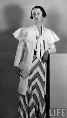 1930's fashion - we heart vintage, not a fan of that dress, love the ruffled jacket- wish it tucked in a little more at the waist.
