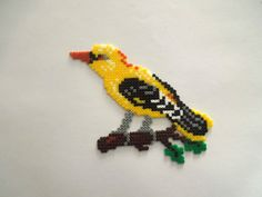 Bird  hama mini beads by Cristina Arribas