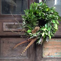 Bay Rosemary Pine Teasel Alder and Pheasant feather wreath