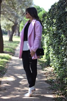 Reach for a dusty pink coat and black destroyed slim jeans for a casual level of dress. Round off this look with white leather pumps.  Shop this look for $181:  http://lookastic.com/women/looks/skinny-jeans-crossbody-bag-pumps-coat-cropped-sweater-crew-neck-t-shirt/5697  — Black Ripped Skinny Jeans  — Black Quilted Leather Crossbody Bag  — White Leather Pumps  — Pink Coat  — Black Cropped Sweater  — White Silk Crew-neck T-shirt