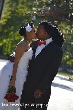 wedding photography fresh roses red bowtie long dreads bride and groom chiffon wedding dress