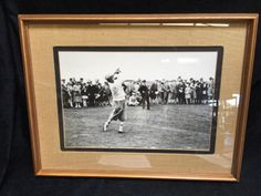 """FRAMED AND MATTED VINTAGE BLACK AND WHITE GOLF PHOTO FEATURING BOBBY JONES IN A FOLLOW THROUGH SWING. SOME GOLF PUNDITS BELIEVE JONES WAS THE """"GREATEST"""" GOLFER OF ALL TIME, WINNING THE """"GRAND SLAM"""" OF GOLF IN THE SAME YEAR, 1930 WHILE PLAYING AS AN AMATEUR. JONES WAS ONE OF THE FOUNDERS OF THE AUGUSTA GOLF CLUB WHERE THE MASTER IS PLAYED ANNUALLY MEASURES 20H X 26W"""