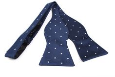 Bow Tie Untied by OTAA - The fabric is designed with white spread out polka dots upon a canvas of navy blue which complements each other resulting in a distinguished, finished look. Purchase Bow Ties from www.otaa.com.au | Shipping World Wide  | Only $20 AUD
