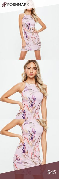 "Missguided purple floral dress size 2 This bodycon dress features a lilac shade with a floral print, a mini length and 90s neckline.  95% polyester 5% elastane   approx length: 79cm/31"" (based on a uk size 8 sample)   Model wears a uk size 8 / eu size 36 / us size 4   product number: z9212444 machine washable  New with tags comes from a pet and smoke free home. :) Missguided Dresses Mini"