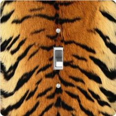 """Rikki KnightTM Tiger Design - Single Toggle Light Switch Cover by Rikki Knight. $13.99. The Tiger Design single toggle light switch cover is made of commercial vibrant quality masonite Hardboard that is cut into 5"""" Square with 1'8"""" thick material. The Beautiful Art Photo Reproduction is printed directly into the switch plate and not decoupaged which make these Light Switch Plates suitable for use in any room in the office, home, etc. etc.. These Light Switch P..."""