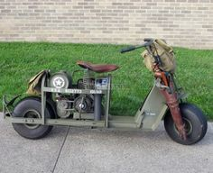 In the later stages of the war in Europe, Allied paratroopers used these scooters to maintain contact between units, increase their mobility and haul small loads. The Cushman Motor Works designed the Model 53 Airborne Scooter to be airdropped by parachute or carried by glider. Some scooters, like this one, had a hitch to pull a model M3A4 general-purpose utility cart. By adding certain equipment, the cart could be converted to carry a .30-cal. or .50-cal. machine gun or even an 81mm mortar.