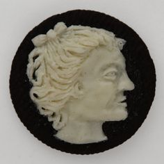 A Cameo carved out of Oreo frosting by Judith G. Klausner. That is wild!!