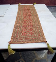 Items similar to Handmade cross-stitched runner - Elaborate Byzantine style design- Gold thread stitched - Living room/ dining table decoration-OOAK - 233 on Etsy Dining Table In Living Room, Embroidery Online, Byzantine, Handmade Shop, Cross Stitch Patterns, Bohemian Rug, Outdoor Blanket, Traditional, Tablerunners