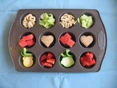 """whole grain, gluten free vanilla alphabet cookies, iceberg lettuce """"chips"""", PB and J heart sandwich, watermelon, strawberries, and ranch dip with green bell peppers"""