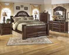 Deep dark red finish with replicated mahogany grain. Richly finished beads, carvings and rope details throughout the collection. Enormous poster bed with storage footboard option.