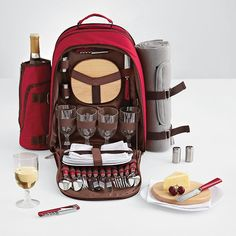 This canvas backpack comes with pretty much everything needed for a picnic for four (well, except for food...). Besides the standard stuff like plates, silverware, cups, and napkins, it also includes a bread knife, a wooden cutting board, salt and pepper shakers, a corkscrew, a picnic blanket, and a detachable wine cooler. Oh yeah, and a central insulated pocket for your food :)