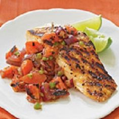 The salsa brings the heat as a topping to the salmon, but if you prefer a milder relish, remove seeds from the jalapeño before grilling. Serve with lime wedges for a pretty presentation. View Recipe: Grilled Salmon with Smoky Tomato Salsa Best Salmon Recipe, Grilled Salmon Recipes, Healthy Salmon Recipes, Grilled Seafood, Fish Recipes, Seafood Recipes, Cooking Recipes, Healthy Dishes, Tilapia Recipes