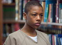 """This prisoner's name is Poussey, pronounced """"pooh-say"""" (""""accent à droite, bitch!""""), and her friendship with Taystee is one of the most heartwarming aspects of the show. Plus, it provides the most hilarious exchanges: """"Let's talk about healthcare, Mackenzie."""" """"Oh, Amanda! I'd rather not! It's not polite..."""" She's played by Samira Wiley."""