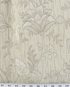 Medium Weight Drapery / Medium Weight Upholstery A tone-on-tone floral jacquard in ivory/champagne with chenille flowers on a crinkled background.