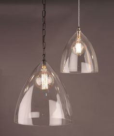 The Ledbury Glass Pendant Light is a simple yet stylish, modern and contemporary clear glass ceiling light The lovely clear, curved, glass shade is hand blown in the UK and available in a wide variety of sizes and finishes Clear Glass Pendant Light, Glass Pendants, Cool Chandeliers, Chandelier Lighting, Creative Lamps, Cage Light, Glass Ceiling Lights, Hallway Designs, Home Decor Lights