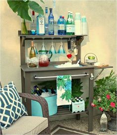 Who says potting benches are just for plants?  Why not turn one into an outdoor bar, like this one from The Creativity Exchange.  Cheers! via Centsational Girl