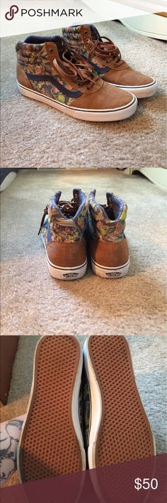Like New Vans HiTops These Vans are SOO cute! Brown leather finish with a navy floral design. I wore these once to a convention last year and walked outside briefly so they are in near-PERFECT condition. Vans Shoes Sneakers