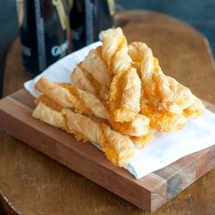 Recipe for the famous Rich's Department Store (Atlanta) Puff Pastry Cheese Straws. Sharp cheddar and Parmesan encased in light, flaky puff pastry. From @NevrEnoughThyme http://www.lanascooking.com/puff-pastry-cheese-straws