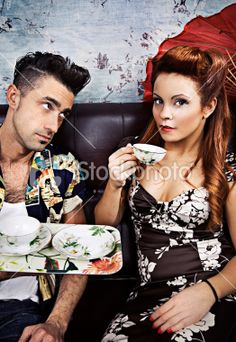 Rockabilly Man and Woman Drinking Tea on Couch Royalty Free Stock Photo