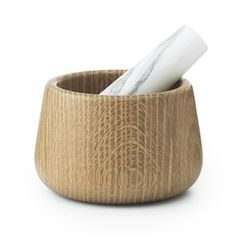 Grind your herbs and spices with the stylish Craft mortar and pestle from Normann Copenhagen. The mortar is made of solid oak with a pestle in marble which is ideal materials when grounding herbs or spices. The simple design makes the mortar and pestle easy to use and the elegant look also makes it a very nice interior detail for the kitchen or table! Choose between different colors.