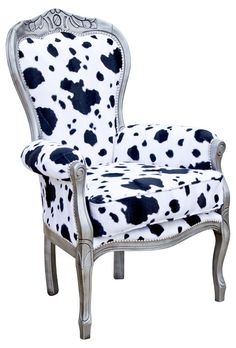Jessica Crested Chair Wow  This is a fabulous chair from our 'Bespoke' range Constructed from genuine Italian classic frame and upholstered by our craftsmen This is a wonderful soft hide like fabric and gorgeous to the touch Upholstered arms and soft padded seat with a firm backrest Give this chair it's appeal Finished in a silver wood finish with matching studs