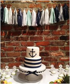 Baby shower cake and tassel garland.  Navy and mint baby shower.