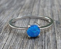 Gorgeous Sterling Silver Ring in round shaped Opal. It is absolutely mesmerizing with revealing rainbow hues that are so lovely to stare at! Wrapped in a