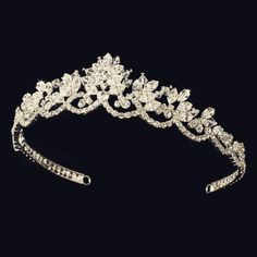 Stunning and vintage-inspired, this tiara shimmers with an artistic arrangement of rhinestones and Swarovski crystals. Perfect for your modern or vintage wedding. The ornamented portion of the band me