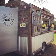 This custom catering trailer - concession trailer was built for Aunt DeeDee's with a rustic farm style in mind.  Mason Jar Lighting, Galvanized paneling, Barnwood Siding and a sliding barn door serving window.  Rustic Food Trucks, Rustic Coffee Cart - Cute Food Cart designs