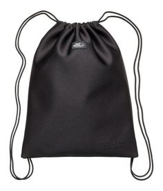 David Beckham Bodywear. Bag in thick, scuba-look fabric. Drawstring at top. Can be used as a backpack. Size 15 1/4 x 20 in.