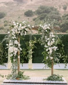 a voluminous ceremony arch highlights white roses at their finest in today's real wedding #NOWonGLW // photographer @ginnysilver // wedding…