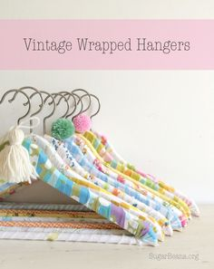 Vintage Wrapped Hangers. Such a great idea for a gift or a kid going to college. Use strips of fabric from home and a glue gun.