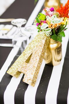 Gold and striped perfection: http://www.stylemepretty.com/california-weddings/2014/10/06/whimsical-diy-wedding-with-pizzaz-at-the-memory-garden/ | Photography: Sorella Muse - http://www.sorella-muse.com/
