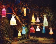 dresses hung from tree and lit inside with lamps it's pretty cute and VERY whimsical way to present color at evening outdoors party event. stylist- JANINE TROTT