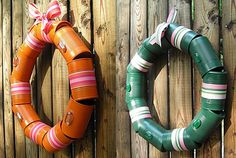 Recycled Wreath~  Decorate cans with paint and paper or ribbon, string in a circle, and hang on your door.