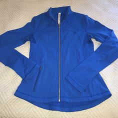 Lululemon forme brushed jacket 6 Good condition Lululemon blue forme jacket in a pretty blue color size 6, a little piling (see last picture) but still has a good amount of wear to go :) it's also brushed inside, no trades. lululemon athletica Jackets & Coats