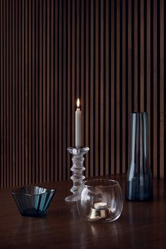 After launching in 1967, designer Timo Sarpaneva's Festivo candleholder became an instant global sensation. In the decades since, it has become a staple of contemporary Finnish design. The ice-like textured surface of the glass object brings a unique, elegant detail to any home interior. The candleholders come in a variety of sizes which create a stunning display alone or grouped together.  Accompanied by Kaasa candleholder, Aalto bowl and Essence pitcher in annual sea blue colour.