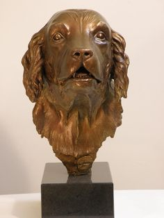 Bruno - a bronze portrait of a beloved family dog, sculpted by Andrew Sinclair