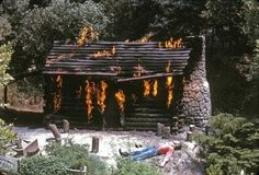 """Burning Settlers Cabin (1965). An early victim of political correctness in the park, the cabin was later changed to a """"Moonshiner's Cabin"""" where the 'shiner in question had set his own cabin ablaze when his still exploded in the 70's. Then it was another accidental fire that threatened an eagle's nest. Finally, it's just a cabin that sits there without comment or story. Sigh."""